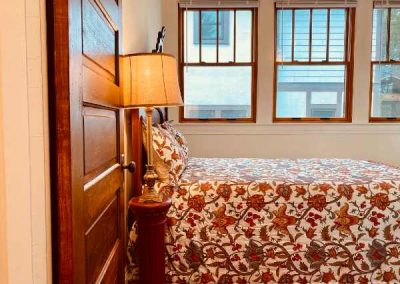 flowery-blanket-on-the bed-Mountaintop-rentals